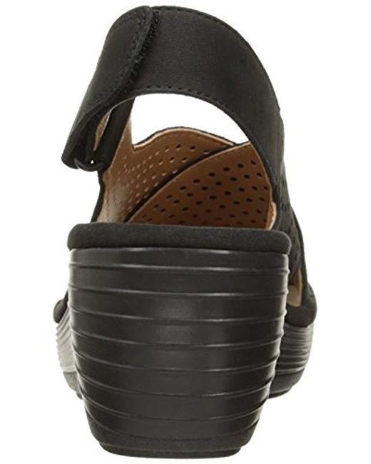 f1360917fded Lyst - Clarks Reedly Variel Wedge Sandal in Black - Save 38%
