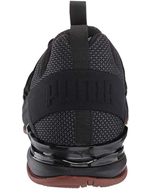 8a68f068feb ... PUMA - Black Axelion Sneaker for Men - Lyst ...