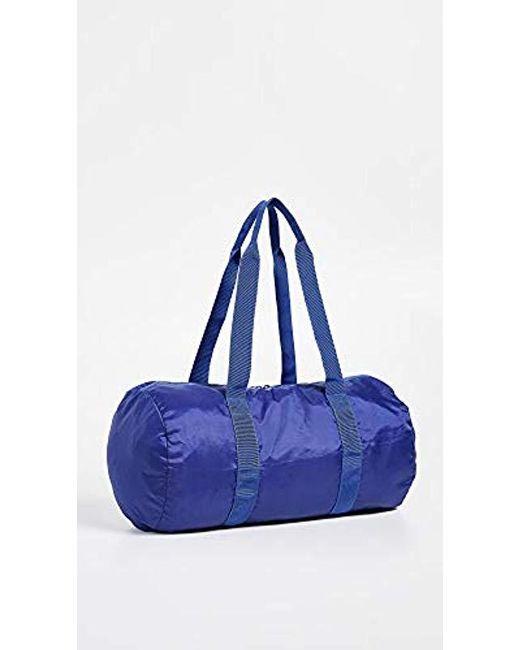 bf1c2fa6f377 ... Herschel Supply Co. - Blue Packable Duffel Bag for Men - Lyst ...