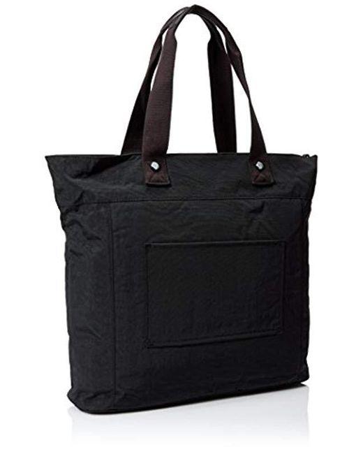 b8b6692167e ... Kipling - Black Lizzie Solid Travel Laptop Tote Shoulder Bag - Lyst ...