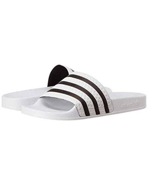 brand new f074a 7e86a Adidas - White Adilette, Zapatos de Playa y Piscina Unisex Adulto for Men -  Lyst ...