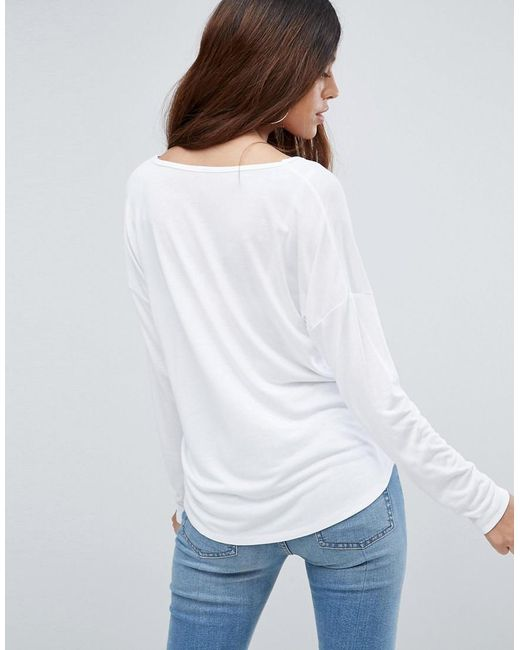 Asos v neck slouchy t shirt with long sleeves in white lyst for Long white v neck t shirt