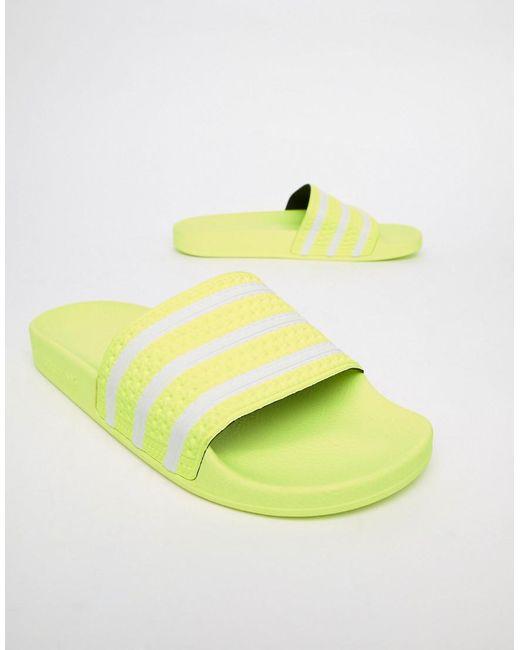 2d02f6b913a7a1 Lyst - adidas Originals Adilette Sliders In Yellow B37957 in Yellow ...