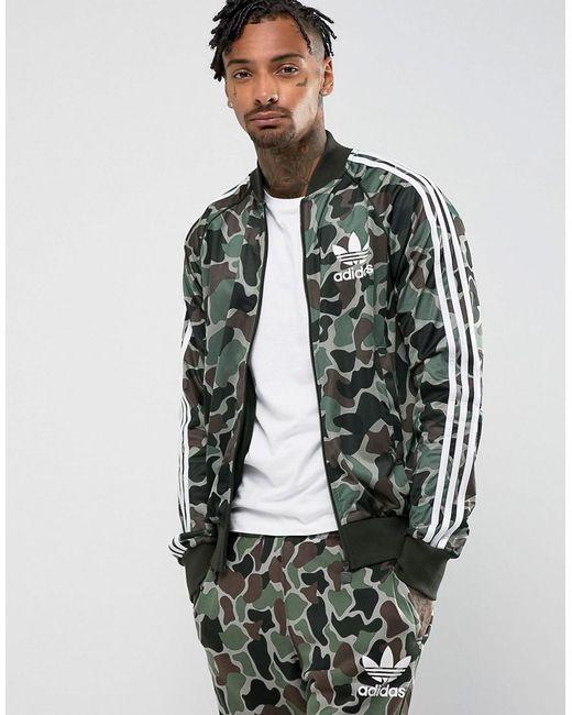 adidas originals superstar camo track jacket in green. Black Bedroom Furniture Sets. Home Design Ideas