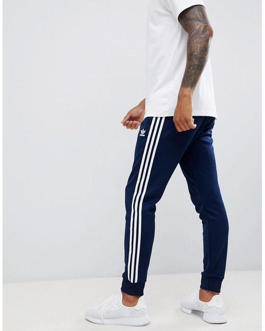 Adidas Originals - Blue 3-stripe Skinny joggers With Cuffed Hem In Navy  Dh5834 for ... 50060ce42ea