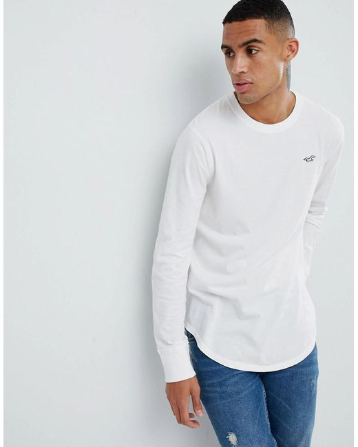 a61561f9f838 Hollister - Curved Hem Long Sleeve T-shirt With Seagull Logo In White for  Men ...