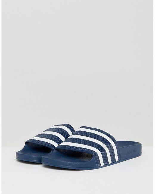sports shoes 8de31 13470 Adidas Originals - Blue Adilette Sliders In Navy for Men - Lyst ...