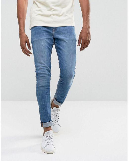 La Conception Des Jeans Super Skinny À 12,5 Onces Délavage Bleu Avec Le Genou Rips - Lavage Mi Asos Bleu