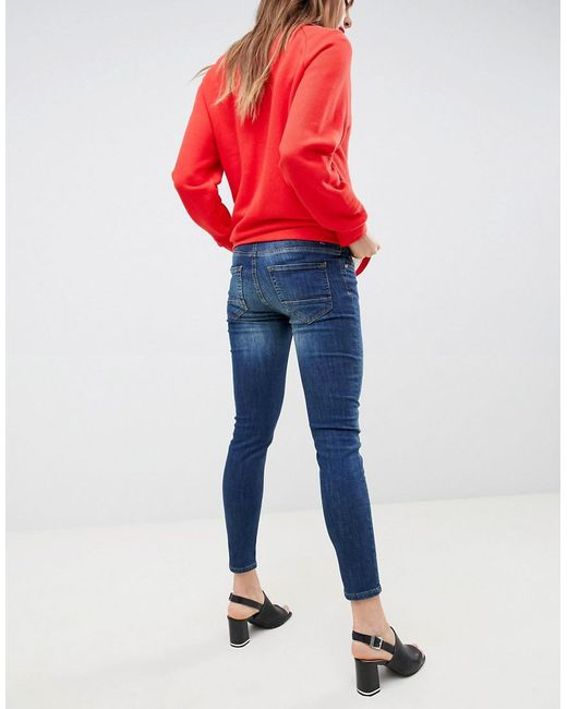 064ac03f393ea ... Gebe Maternity - Blue Over-the-bump Skinny Jeans - Lyst