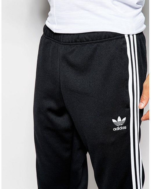 adidas originals superstar cuffed track trousers aj6960 in. Black Bedroom Furniture Sets. Home Design Ideas