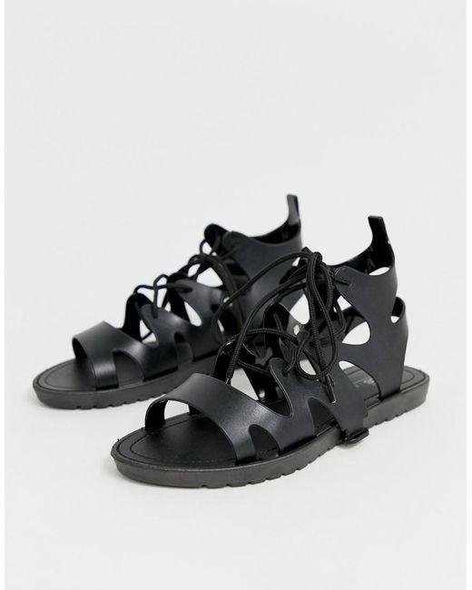 5a215d922d7f9 ... ASOS - Black Felicity Jelly Tie Leg Flat Sandals - Lyst