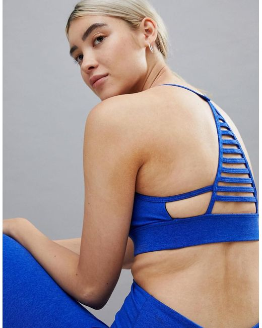 Onzie - Blue Elevate Yoga Bra In Black - Lyst