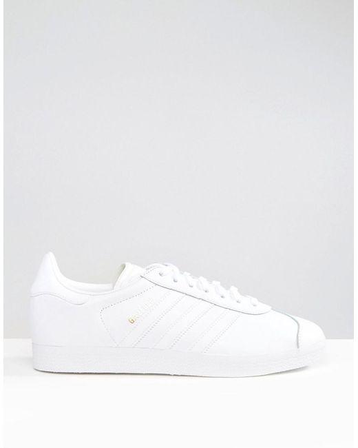 lyst adidas originali gazzella formatori in bianco bb5498 in bianco.