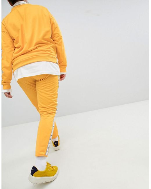 9e0df9f10c ... PUMA - Exclusive To Asos Plus Taped Side Stripe Track Pants In Yellow -  Lyst