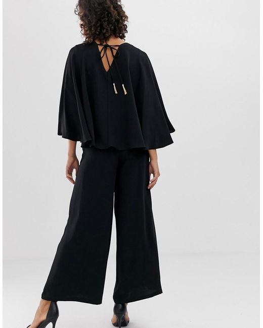 4d7ab771220 River Island Jumpsuit With Cape In Black in Black - Lyst