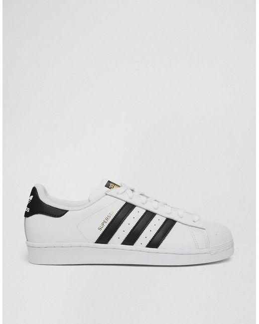 Adidas Originals Superstar formadores en blanco c77124 en negro para hombres