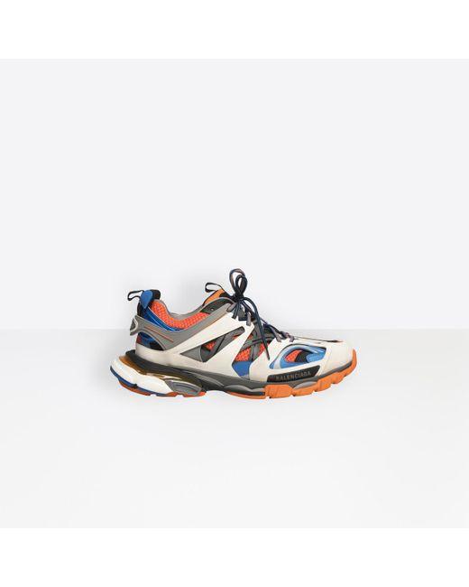 f70e28df5d56 Balenciaga - Orange Track Sneakers for Men - Lyst ...