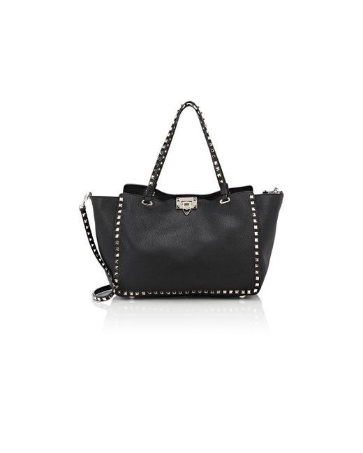 Valentino | Black Women's Rockstud Medium Trapeze Bag | Lyst