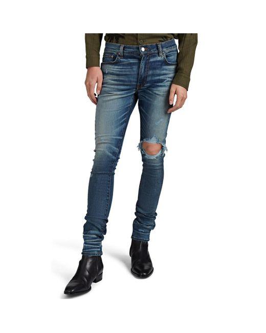 Amiri Blue Broken Distressed Skinny Jeans for men