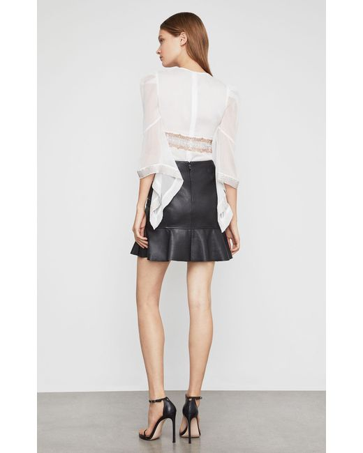 a02ffe6aac ... BCBGMAXAZRIA - Black Bcbg Faux Leather Flounced Skirt - Lyst ...