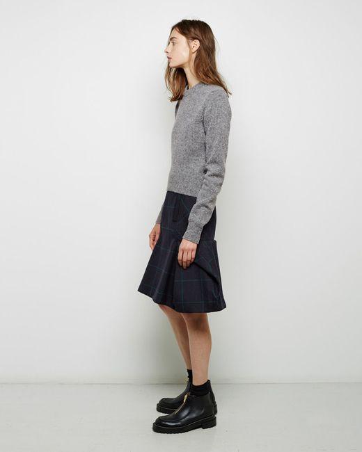 sacai windowpane wool peplum skirt in blue navy green