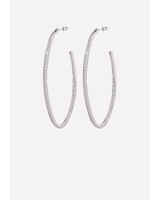 Bebe - Metallic Crystal Oval Hoop Earrings - Lyst