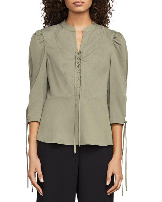 BCBGMAXAZRIA - Green Carli Lace-up Peplum Top - Lyst