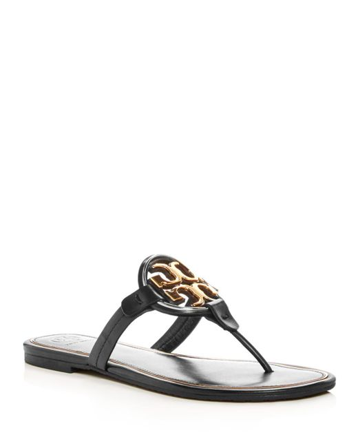 45eb8a6bbf0 Lyst - Tory Burch Miller Flat Metal Logo Slide Sandals in Black ...