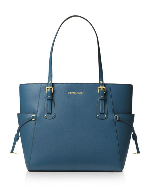 a5e67d5a8bed Lyst - MICHAEL Michael Kors Voyager East West Leather Tote in Blue ...