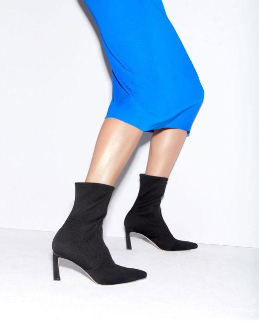 0ada2b007e13 ... Stuart Weitzman - Black Women s Rapture Mid Calf Stretch Sock Booties  ...