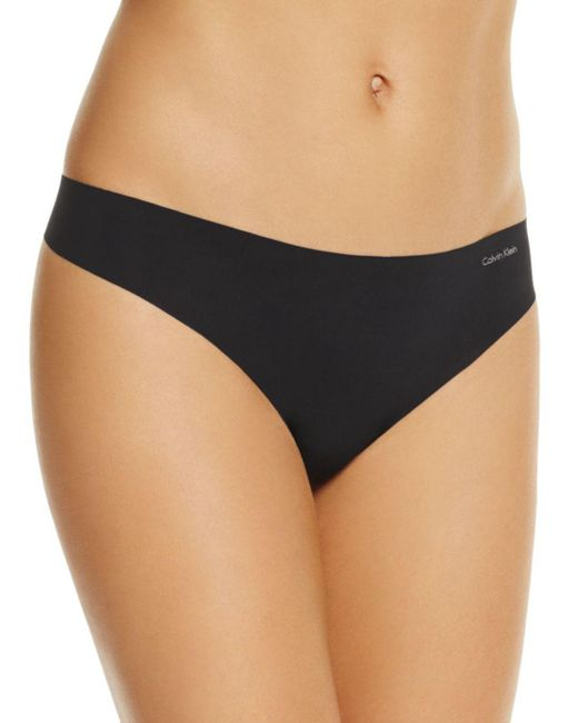Calvin Klein - Natural Invisibles Thong - Lyst