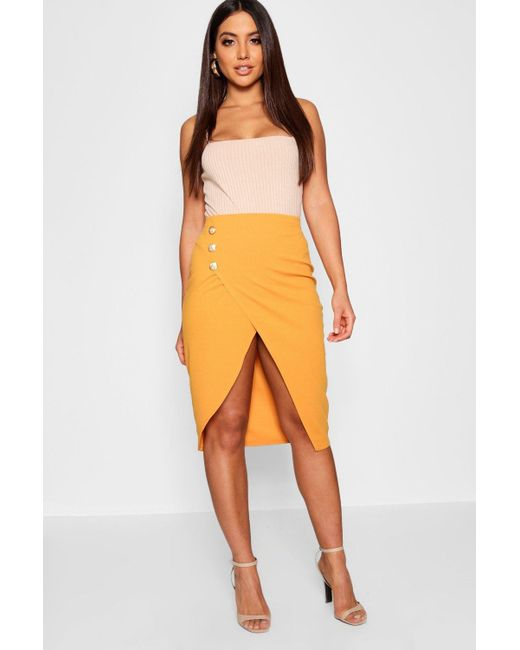 1b367572fd Boohoo - Multicolor Gold Button Asymetric Split Front Midi Skirt - Lyst ...