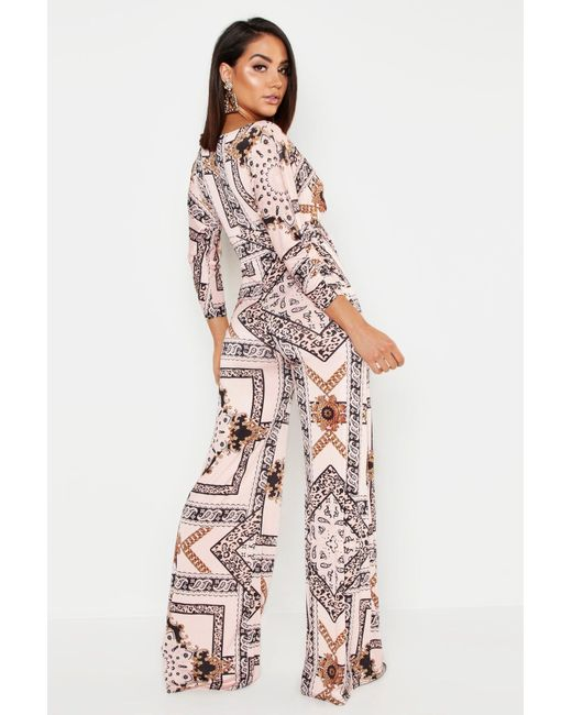 d43bbd442af ... Boohoo - Pink Slinky Chain Print Wide Leg Plunge Jumpsuit - Lyst ...