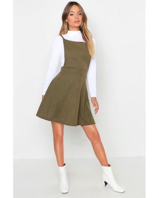 5990f39421 Boohoo - Green Cross Back Pinafore Dress - Lyst ...