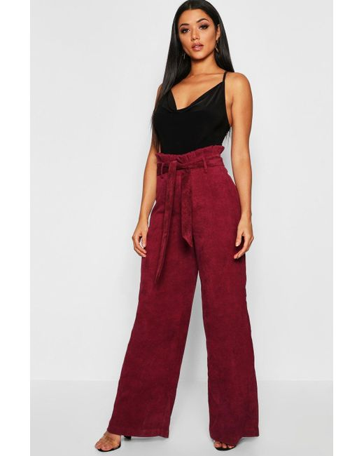 e0271db757 Boohoo - Red Paperbag Tie Waist Cord Wide Leg Trousers - Lyst ...