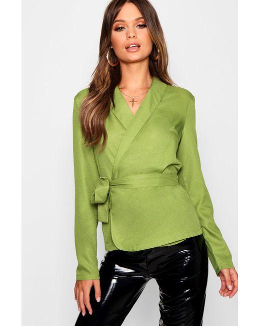de09e00e397ca Boohoo - Green Wrap Front Tie Side Blouse - Lyst ...