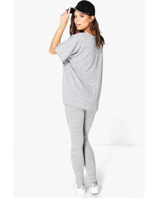 The oversized tops can be worn as dresses or even belted at the waist. You can keep it solo or style with your favorite jeans or leggings. We see a nice combination of wide but cropped perforated top with printed numbers worn with animal print logn shorts.