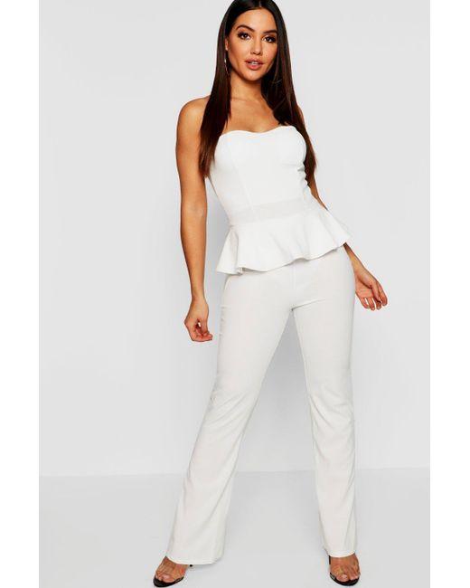 91002c571fc Boohoo - White Peplum Hem Jumpsuit - Lyst ...
