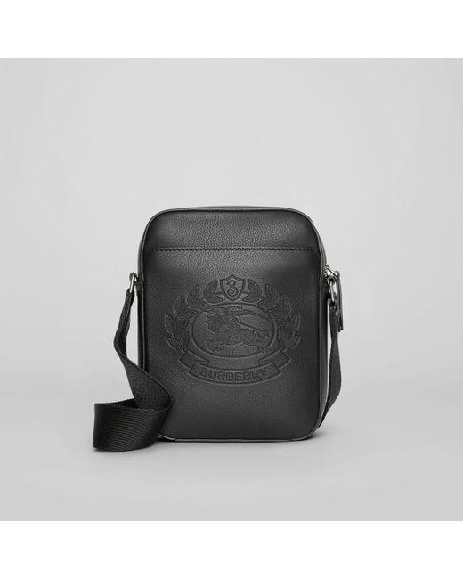 58127c09578b Burberry - Black Small Embossed Crest Leather Crossbody Bag for Men - Lyst  ...