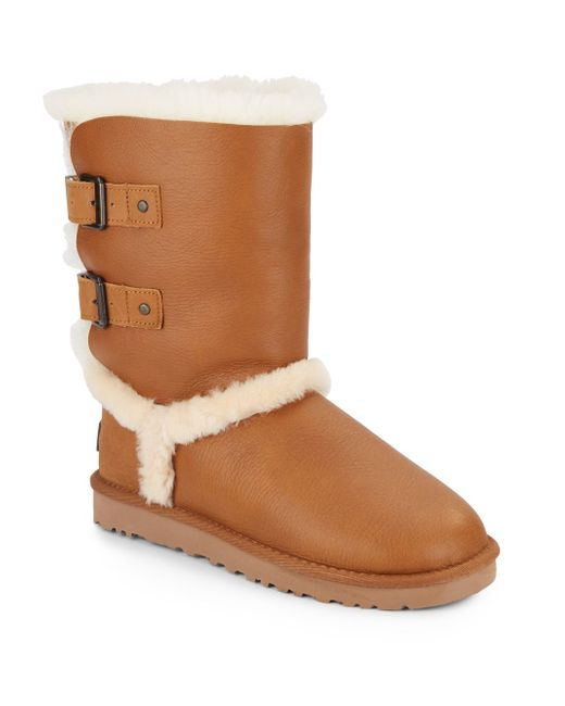 ugg skylah shearling lined leather buckle boots in brown