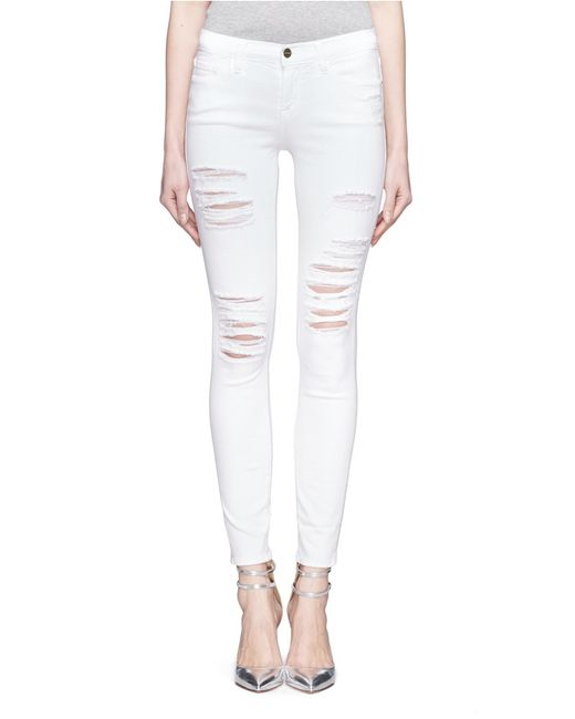 Frame Le Skinny De Jeanne Ripped Jeans In White Save