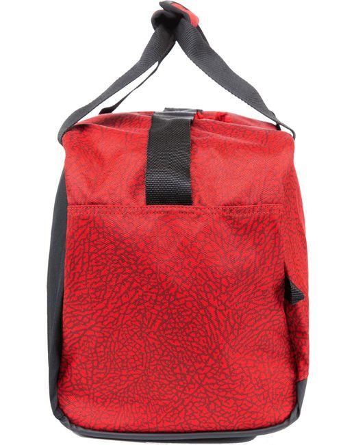 1cc8eeb112b7 ... Nike - Red Elemental Medium Duffle Bag for Men - Lyst ...