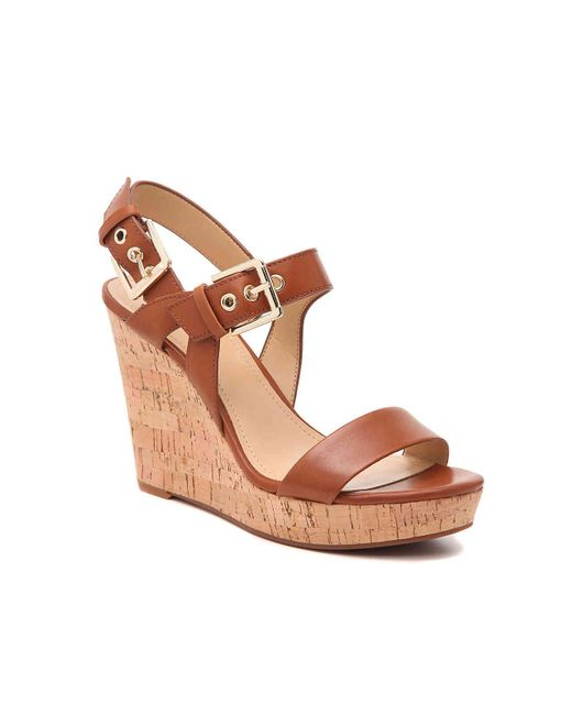 7961ebfdd Nine West Scarlett Wedge Sandal in Brown - Lyst