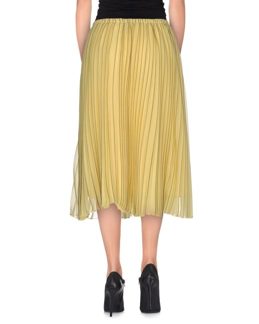 aimo richly knee length skirt in yellow lyst