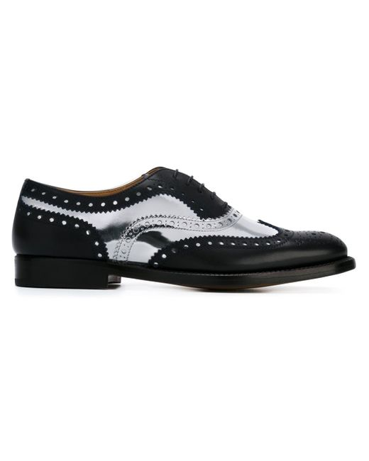 Prada gives classic brogues a refresh with this metallic leather pair. Set on sporty striped foam soles, they're detailed with perforations and pinked xianggangdishini.gq: Prada.