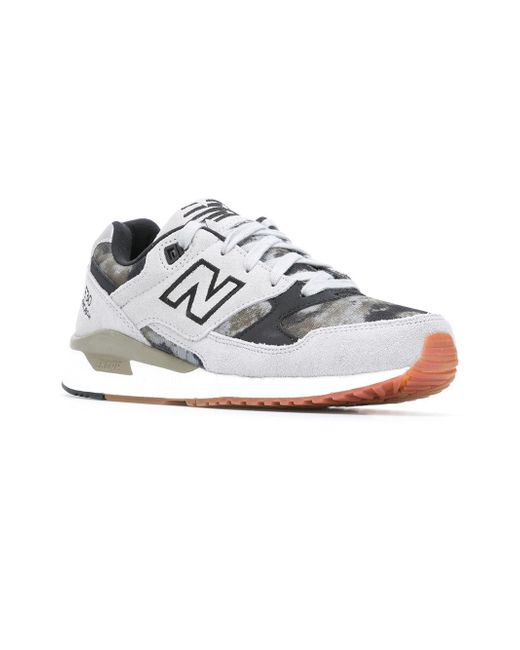 new balance 530 39 encap 39 logo trainers in gray lyst. Black Bedroom Furniture Sets. Home Design Ideas