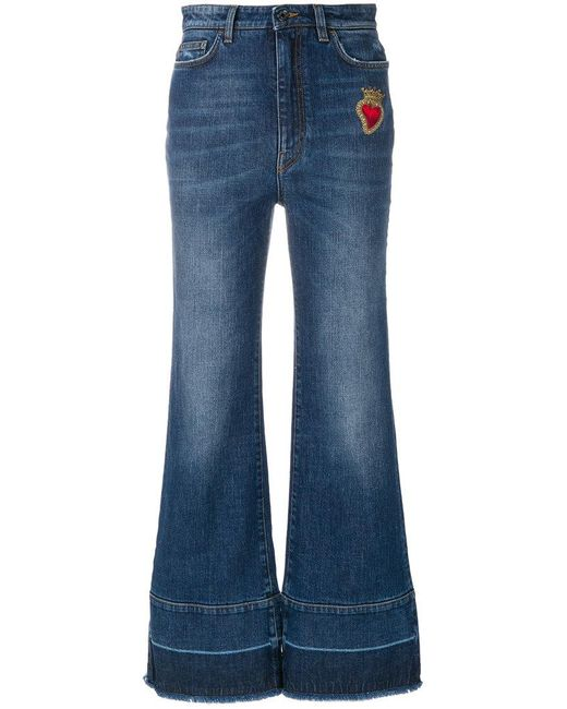 Dolce & Gabbana - Blue Flared Jeans With Sacred Heart Appliqué - Lyst