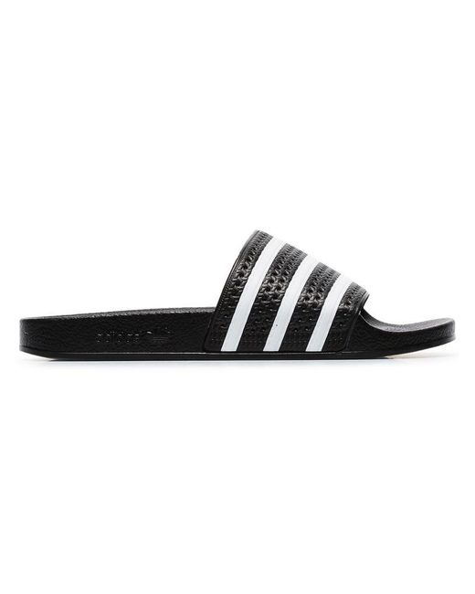 2e35b3283370 adidas Adilette Slides in Black for Men - Save 3% - Lyst