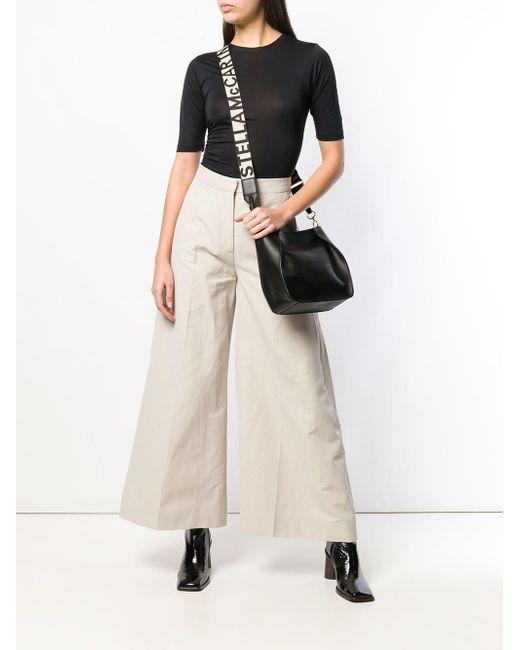 4ed927445ca0e Stella McCartney Logo Shoulder Bag in Black - Save 22% - Lyst