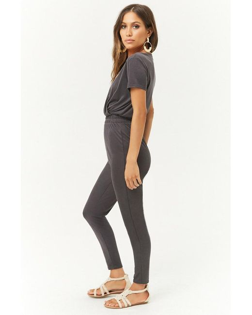 3d0cf6beff3 ... Forever 21 - Black Ribbed Surplice Jumpsuit - Lyst